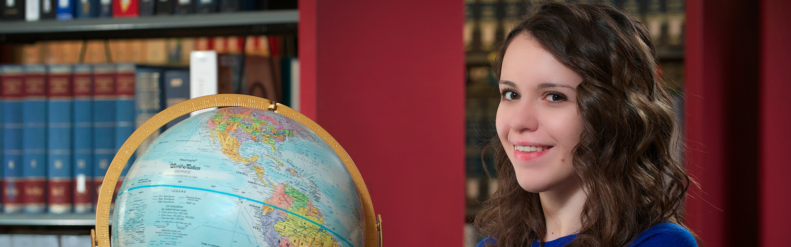 Erin Borchers with a globe
