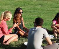 Students talking and laughing on campus lawn