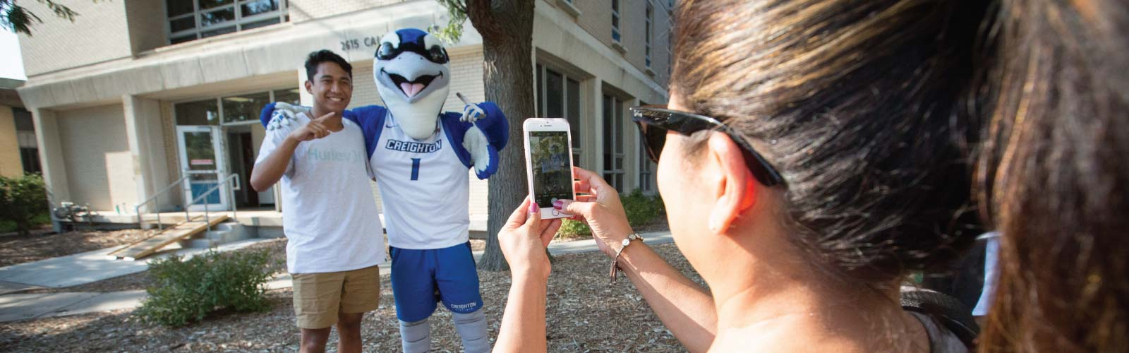 Mom Taking Photo of Student with Billy Bluejay