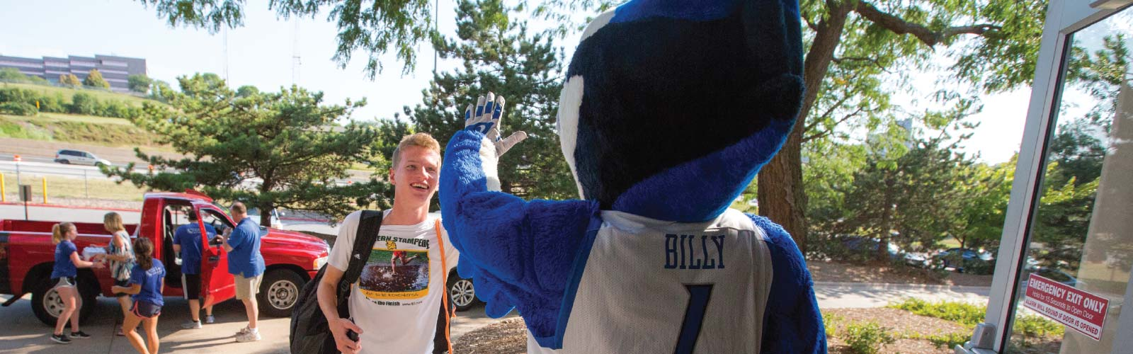 Student Giving a High Five to Billy Bluejay