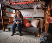 Student in her freshman year residence hall room