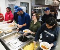 Students serving food at Siena/Francis House